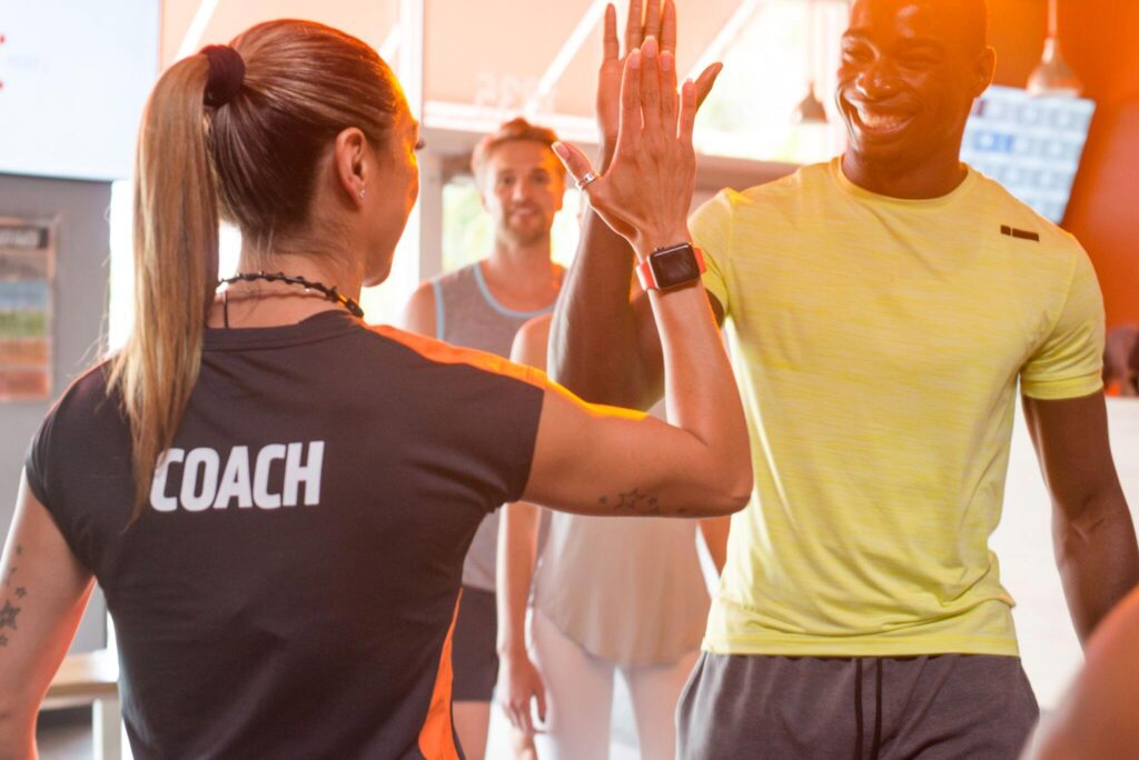 High fives from an Orangetheory coach